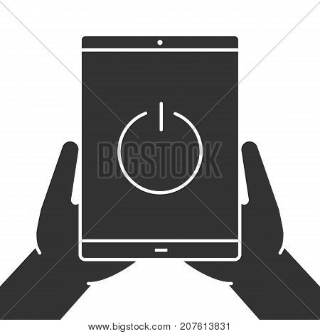 Hands holding tablet computer glyph icon. Device turning off. Silhouette symbol. Tablet pc with power button. Negative space. Vector isolated illustration