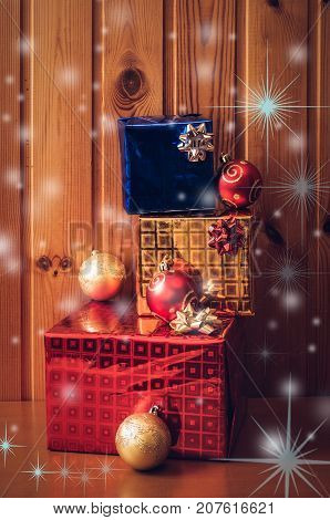 Christmas presents on wooden background. Vintage style