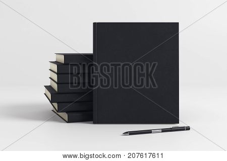 Stack of blank black hardcover organizers on light background. Supplies concept. Mock up 3D Rendering