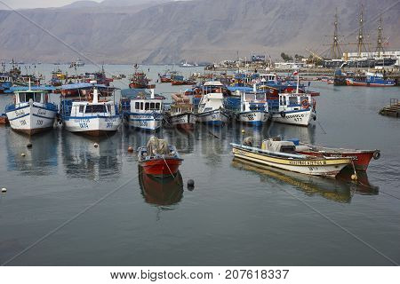 Iquique, Chile - August 28, 2017:  Fishing boats tied up in the fishing harbour of Iquique in northern Chile.