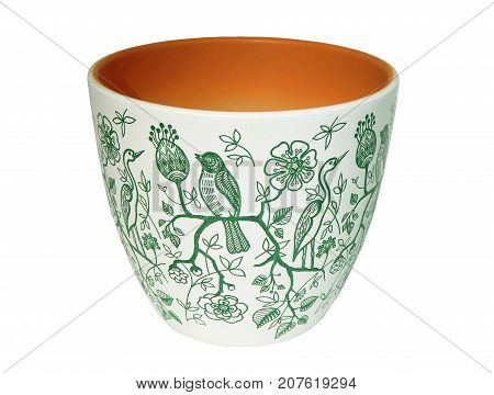 A white ceramic flower pot with a green monochrome graphic pattern of birds and flowers. The garden pot is isolated on white background