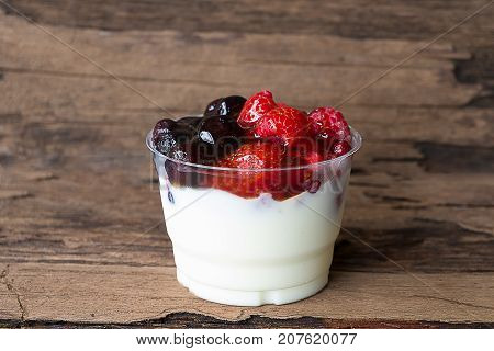 Fruit Yogurt with Strawberry, Raspberry, Blueberry, Canberry, Old Wood Flooring