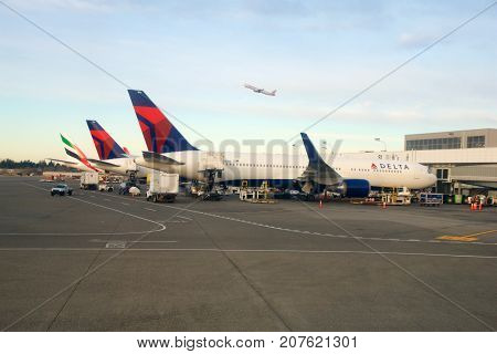 SEATTLE, WASHINGTON, USA - JAN 27th, 2017: Delta Airlines Boeing 767 airplanes prepare for take of at Seattle-Tacoma International Airport SeaTac.