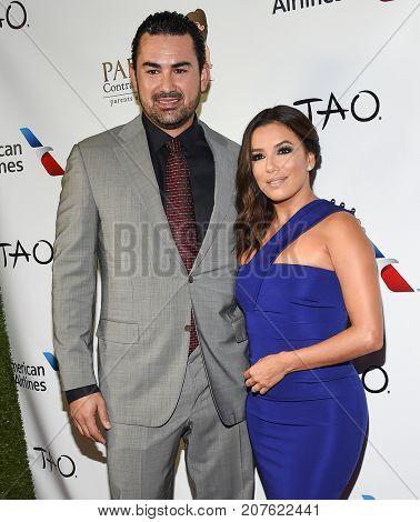 LOS ANGELES - SEP 24:  Adrian Gonzales and Eva Longoria arrives for the 'El Sueno De Esperanza' Celebration on September 24, 2017 in Hollywood, CA