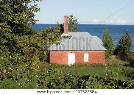 A vintage brick storage building along the shore of Lake Superior