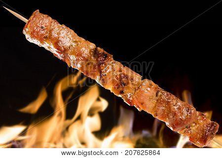 Pork Skewer On A Fire Background. Panceta