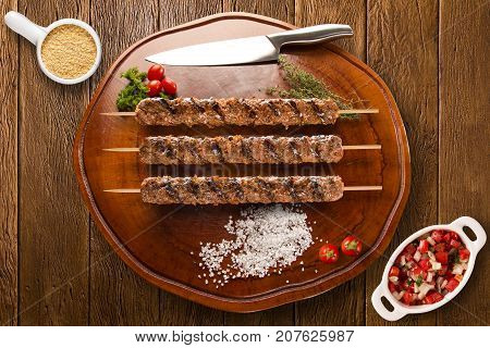 Kafta Steak Skewers On Top Of A Board
