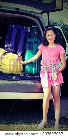 Smiling Little Girl  Load The Car With Luggage