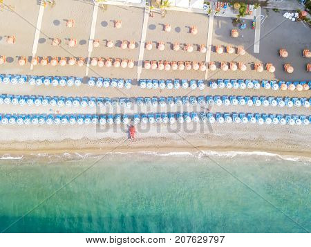 An aerial view of the beach umbrellas at Positano on the Amalfi Coast in Italy