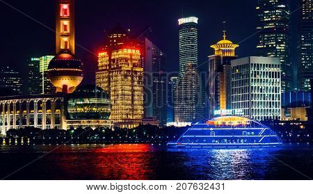 Shanghai, China - Nov 4, 2016: Night view of the Shanghai City skyline. Features closeup view of the Oriental Pearl TV tower and Huangpu River.
