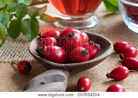 Fresh Rose Hips On A Wooden Spoon