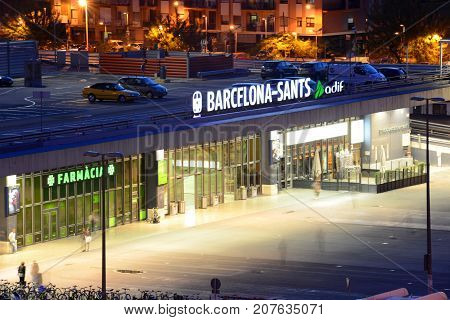 BARCELONA - JUN. 8, 2013: Entrance of Barcelona Sants railway station (Estació de Barcelona-Sants) at night, Barcelona, Catalonia, Spain.
