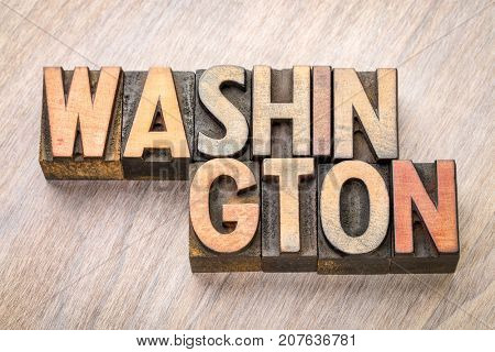 Washington word abstract in vintage letterpress wood type printing blocks against grained wooden background