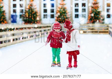 Kids Ice Skating In Winter. Ice Skates For Child.
