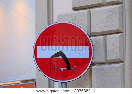 Road sign with an arm that comes out from signal street art metropolitan art