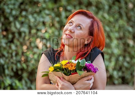 An attractive Caucasian young woman with red hair holding a flower bouquet with a romantic look. Romance, love story concept, first date, romantic mood, in love illustration.