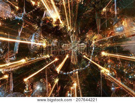 Abstract Cross Ornament on Christmas Tree with Beams of Light