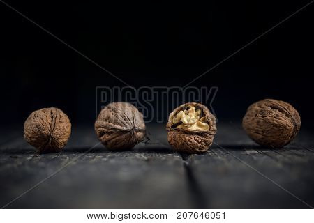 Walnuts On A Grey Textured Wooden Table. Assortment Of Nuts Isolated On Rustic Old Wooden Background
