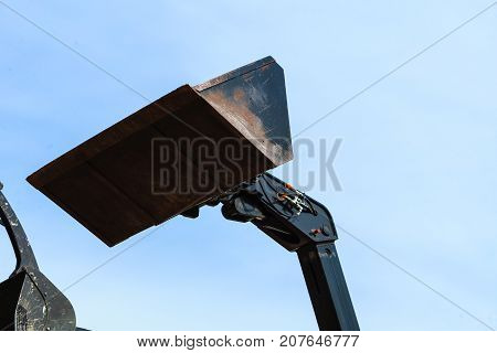 Bucket Loader With Blue Sky In Background