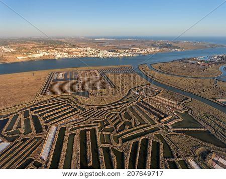 Aerial. Textured fields of swampy salt lakes. Salines of Portugal.