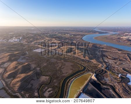 Aerial. Textured fields of swampy salt lakes. Salines of Portugal. Vila Real Santo Antonio.