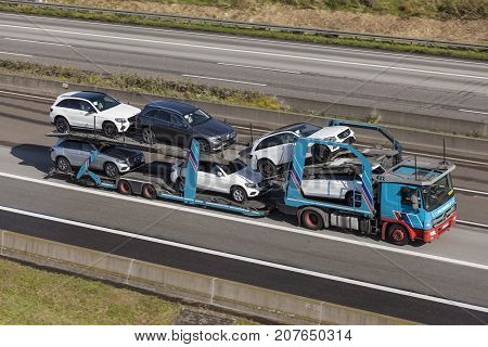 Frankfurt Germany - Sep 19 2017: Mercedes Benz Actros car transporter hauls Mercedes Benz SUVs along the A45 highway in Germany