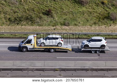 Frankfurt Germany - Sep 19 2017: Fiat Ducato car transporter with a trailer loaded with new Suzuki cars on the highway