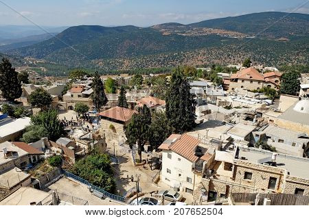 SAFED ISRAEL - SEPTEMBER 25 2017: View of the sacred Jewish city of Safed and the Galilee Mountains