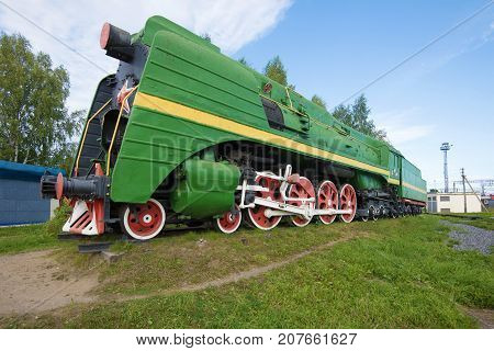 SHARE, RUSSIA - SEPTEMBER 04, 2017: High-speed passenger steam locomotive P-36 (0147) - a monument on the Sharya station