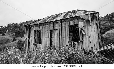 Old abandoned outback farming shed in Queensland. poster