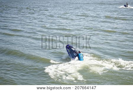 Rostov-on-Don Russia- September 162017: Athlete on a stunt boat performs in front of the audience at the celebration of the day of the city of Rostov-on-Don
