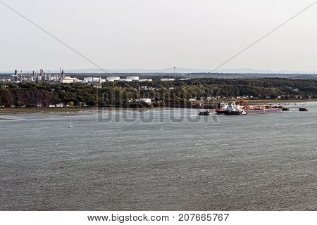Cityscape or skyline of the Saint Lawrence river with Jean Gaulin Oil Refinery from plaines d'Abraham Quebec City Canada