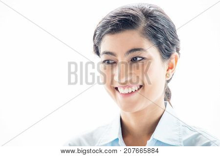 Positive beautiful Asian woman looking away and thinking of business development. Ambitious young businesswoman against white background. Young specialist or intern concept