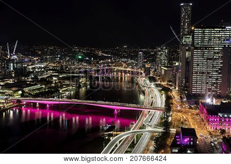 BRISBANE, AUSTRALIA - SEPTEMBER 30 2017: Aerial nightscape over Brisbane CBD, with a view of city traffic over Victoria Bridge and Pacific highway entrances into the city including North Quay.