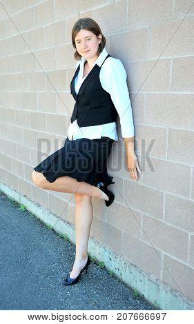 Female nanny in uniform taking a break outside.