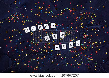 Flatlay of Colorful Round Candy Confetti and text Happy New Year