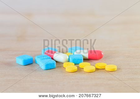 pills and capsule On wooden floor with copy space add text ( high definition image )