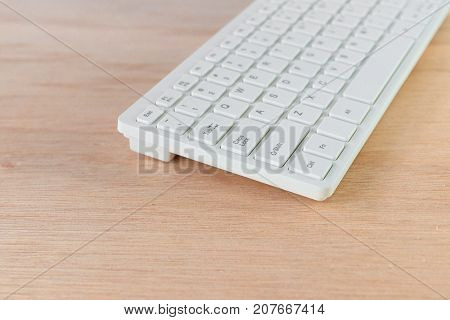 computer keyboard white on wooden floor with copy space add text ( high definition image )