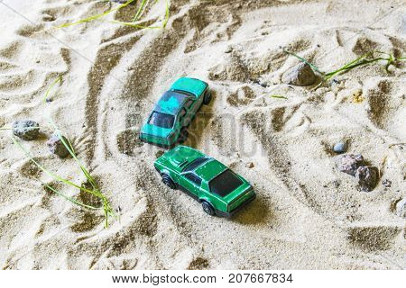 Racing Cars On The Sand Compete In A Game Of Survival.