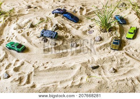 Racing Cars On The Sand Compete In The Game.