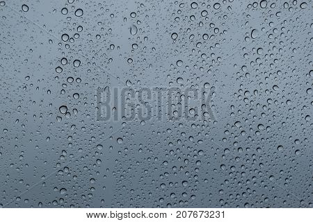 Water drop at the window glass transparent On the day of inclement weather and heavy rain