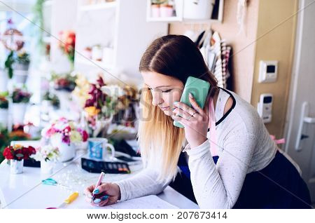 Florist Woman Taking Order By The Cellphone