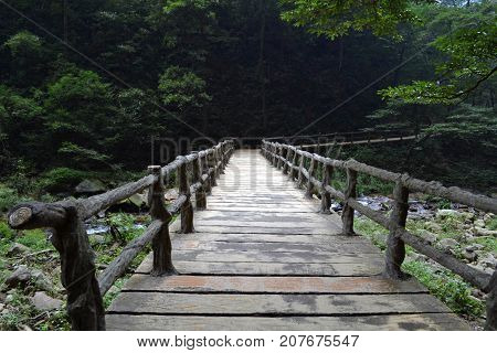 Bridge And Rope Around The Park Trail In Wulingyuan Scenic Area. Greenies Everywhere And River Along