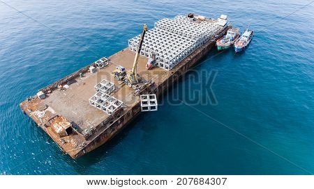 The Transport Barge Floating At The Artificial Reef Drop Zone.