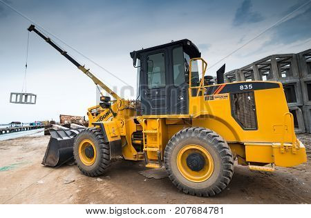 The Wheel Loader Moving The Cement Artificial Reef.