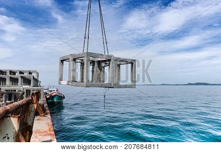 The Crane On  Barge Droping The Artificial Reef.