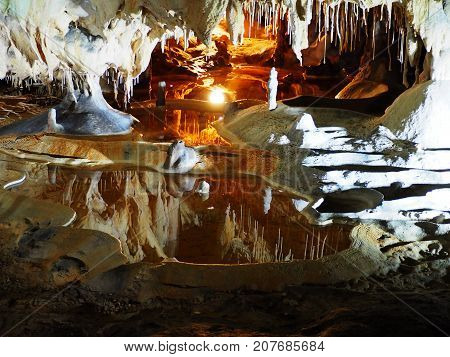 Beautiful cave with water, stalagmites and stalactite