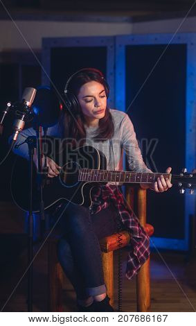 Female Singer Recording In Professional Music Studio