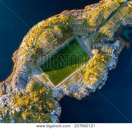 Football field in Henningsvaer from above. Henningsvaer is a fishing village located on several small islands in the Lofoten archipelago in Norway