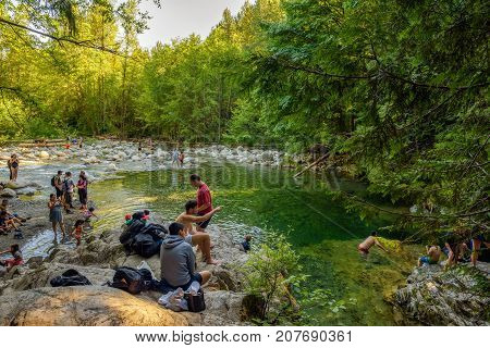 LYNN CANYON PARK, CANADA - JULY 3, 2017 : People visiting the 30 Foot Pool in Lynn Canyon Park in North Vancouver.